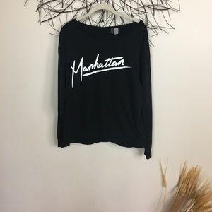 H&M DIVIDED black soft MANHATTAN sweater. Graphic